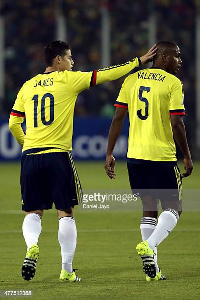 James Rodriguez of Colombia touches his teammate Edwin Valencia during the 2015 Copa America Chile Group C match between Brazil and Colombia at...