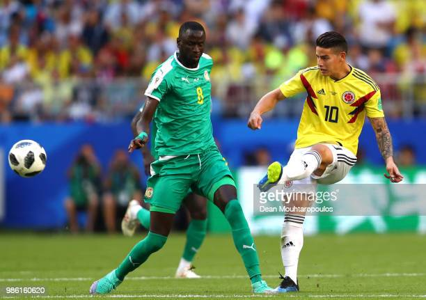 James Rodriguez of Colombia under pressure from Cheikhou Kouyate of Senegal during the 2018 FIFA World Cup Russia group H match between Senegal and...