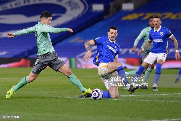 James Rodriguez of Everton and Lewis Dunk challenge for the ball during the Premier League match between Brighton and Hove Albion and Everton at the...