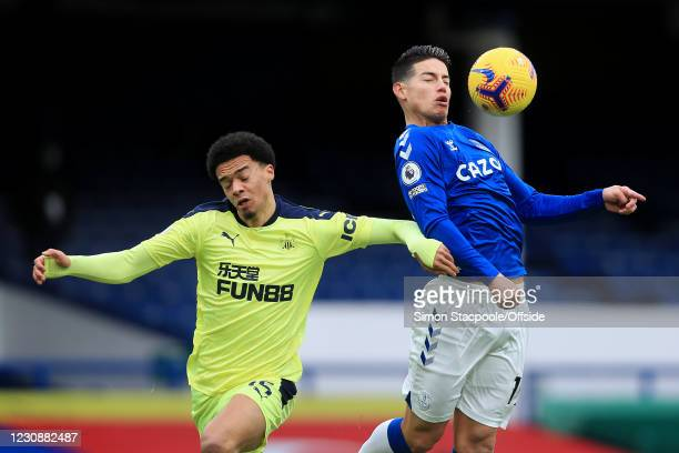 James Rodriguez of Everton battles with Jamal Lewis of Newcastle United during the Premier League match between Everton and Newcastle United at...
