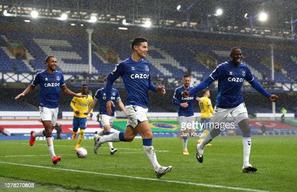 James Rodriguez of Everton celebrates after scoring his team's third goal during the Premier League match between Everton and Brighton Hove Albion at...