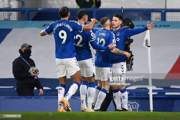 James Rodriguez of Everton celebrates after scoring their sides first goal with team mates during the Premier League match between Everton and...