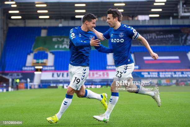 James Rodriguez of Everton celebrates scoring his teams first goal with team mate Seamus Coleman during the Premier League match between Everton and...