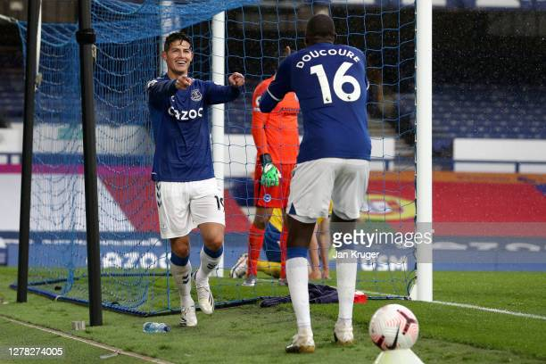 James Rodriguez of Everton celebrates with teammate Abdoulaye Doucoure after scoring his team's fourth goal during the Premier League match between...