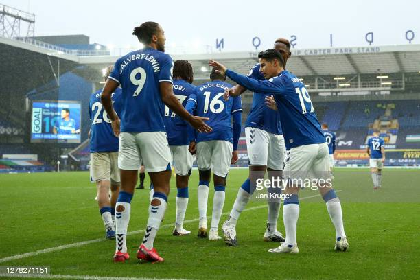 James Rodriguez of Everton celebrates with teammates after scoring his team's third goal during the Premier League match between Everton and Brighton...