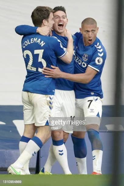 James Rodriguez of Everton celebrates with teammates Seamus Coleman and Richarlison after scoring their team's first goal during the Premier League...