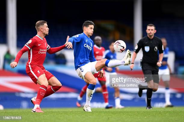 James Rodriguez of Everton controls the ball under pressure from Jordan Henderson of Liverpool during the Premier League match between Everton and...