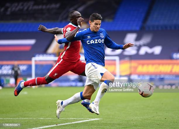 James Rodriguez of Everton is challenged by Sadio Mane of Liverpool during the Premier League match between Everton and Liverpool at Goodison Park on...