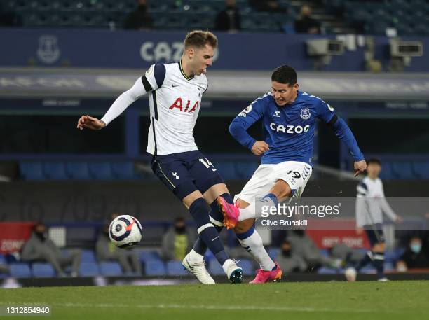 James Rodriguez of Everton shoots under pressure from Joe Rodon of Tottenham Hotspur during the Premier League match between Everton and Tottenham...
