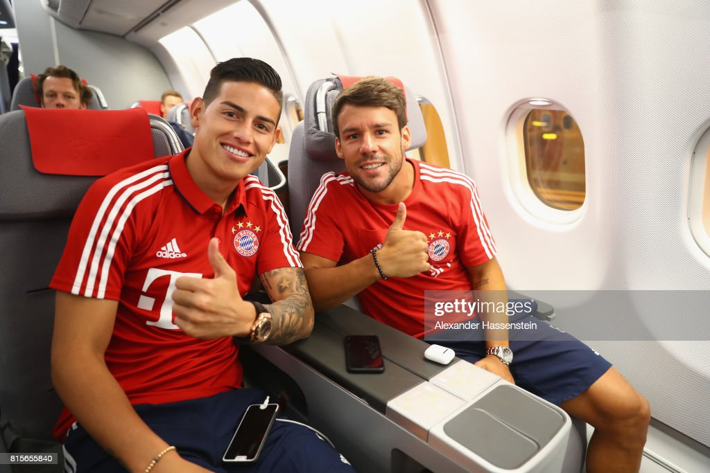 James Rodriguez (L) of FC Bayern Muenchen and his team mate Juan Bernart on board on the team flight to Shanghai for the FC Bayern Muenchen Pre-Season Tour on July 16, 2017 in Munich, Germany.