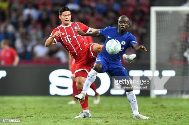 James Rodriguez of FC Bayern Muenchen and N'Golo Kante of Chelsea FC competes for the ball during the International Champions Cup match between...