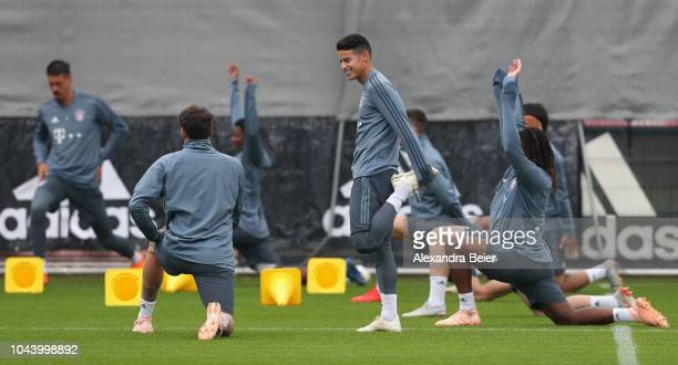 James Rodriguez of FC Bayern Muenchen and teammates warm up during a training session at the club's Saebener Strasse training court on October 1 2018...