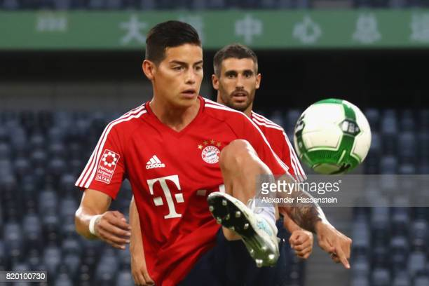 James Rodriguez of FC Bayern Muenchen battles for the ball during a training session at Shenzhen Universiade Sports Centre during the Audi Summer...
