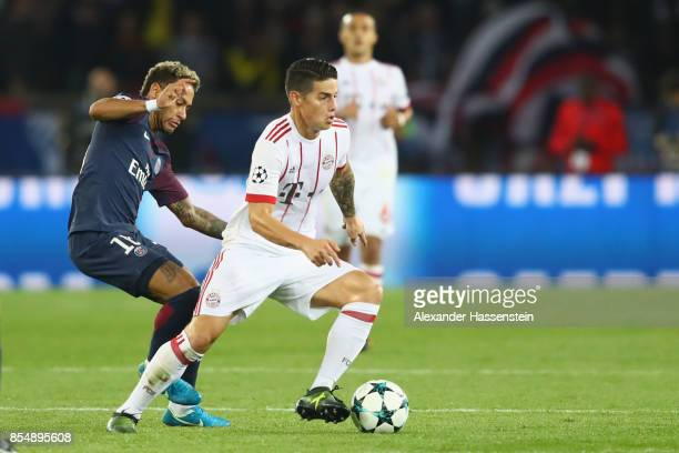 James Rodriguez of FC Bayern Muenchen battles for the ball with Neymar during the UEFA Champions League group B match between Paris SaintGermain and...