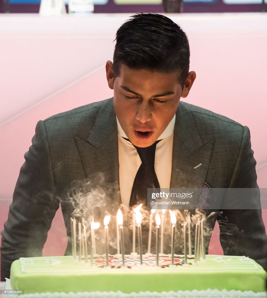 James Rodriguez of FC Bayern Muenchen blows out candles on a birthday cake after a press conference at Allianz Arena on July 12, 2017 in Munich, Germany.