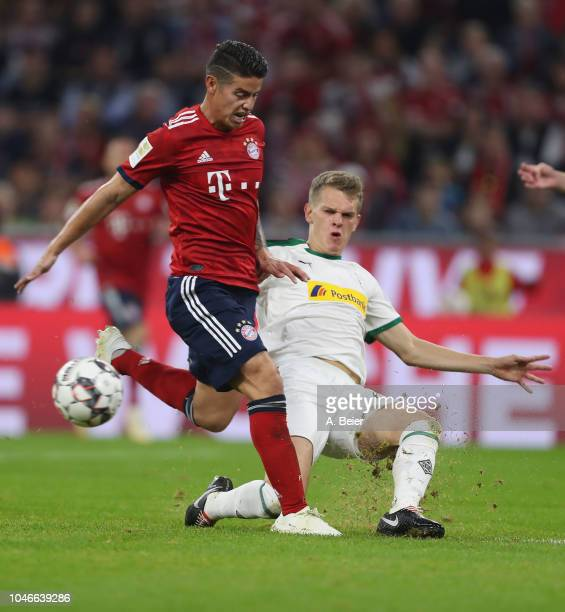 James Rodriguez of FC Bayern Muenchen fights for the ball with Matthias Ginter of Borussia Moenchengladbach during the Bundesliga match between FC...