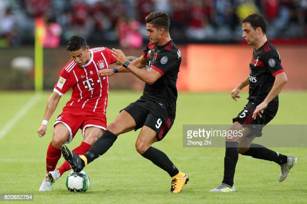 James Rodriguez of FC Bayern Muenchen in action against Andre Silva and Giacomo Bonaventura of AC Milan during the 2017 International Champions Cup...