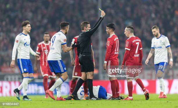 James Rodriguez of FC Bayern Muenchen is shown a yellow card during the Bundesliga match between FC Bayern Muenchen and FC Schalke 04 at Allianz...