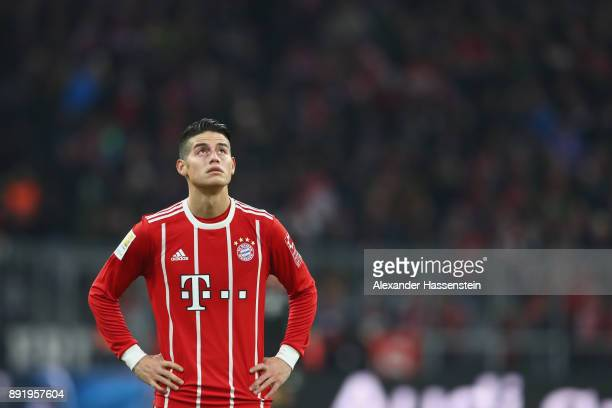 James Rodriguez of FC Bayern Muenchen looks on during the Bundesliga match between FC Bayern Muenchen and 1 FC Koeln at Allianz Arena on December 13...