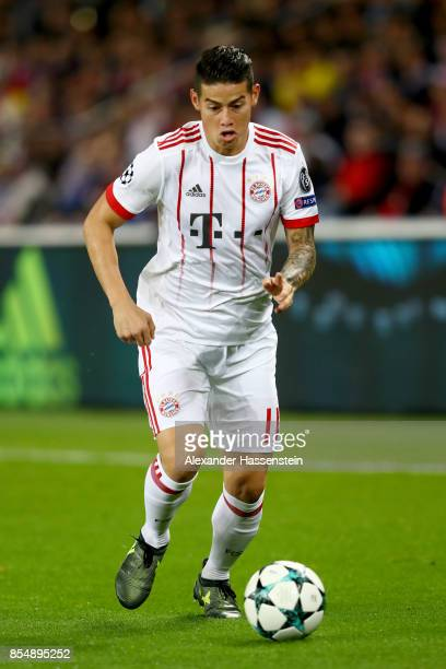 James Rodriguez of FC Bayern Muenchen runs with the ball during the UEFA Champions League group B match between Paris SaintGermain and Bayern...