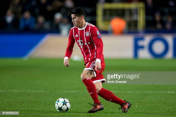 James Rodriguez of FC Bayern Muenchen runs with the ball during the UEFA Champions League group B match between RSC Anderlecht and Bayern Muenchen at...