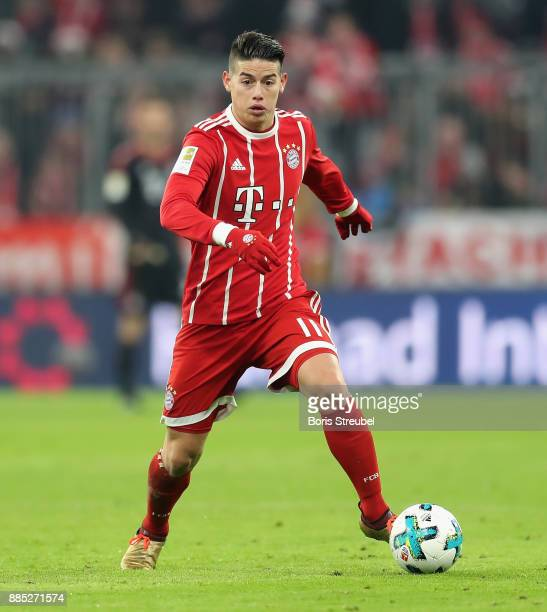 James Rodriguez of FC Bayern Muenchen runs with the ball during the Bundesliga match between FC Bayern Muenchen and Hannover 96 at Allianz Arena on...