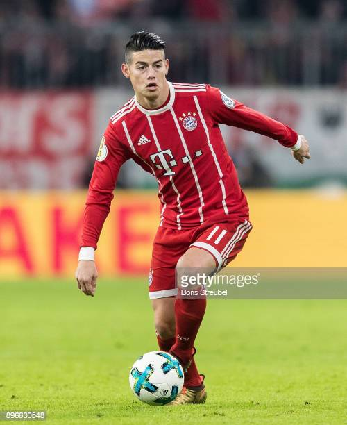 James Rodriguez of FC Bayern Muenchen runs with the ball during the DFB Cup match between Bayern Muenchen and Borussia Dortmund at Allianz Arena on...