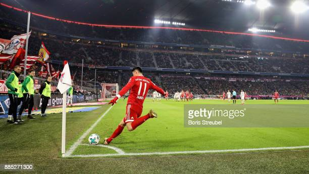 James Rodriguez of FC Bayern Muenchen takes a corner during the Bundesliga match between FC Bayern Muenchen and Hannover 96 at Allianz Arena on...