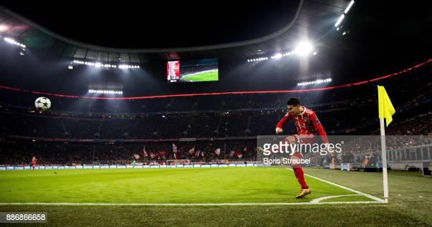 James Rodriguez of FC Bayern Muenchen takes a corner during the UEFA Champions League group B match between Bayern Muenchen and Paris SaintGermain at...
