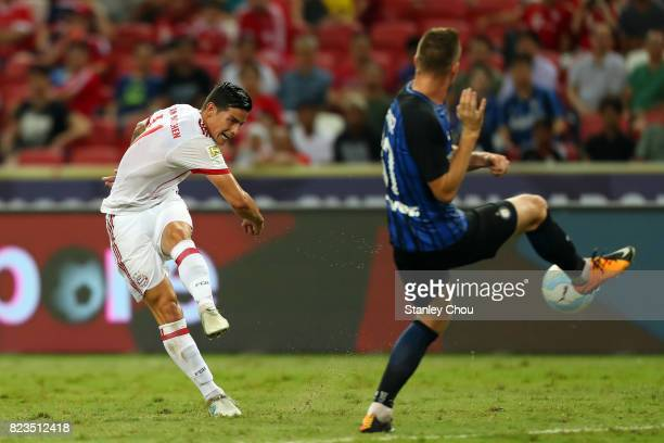 James Rodriguez of FC Bayern shoots during the International Champions Cup match between FC Bayern and FC Internazionale at the National Stadium on...