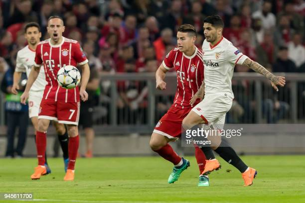 James Rodriguez of Muenchen and Ever Banega of Sevilla battle for the ball during the UEFA Champions League quarter final second leg match between...