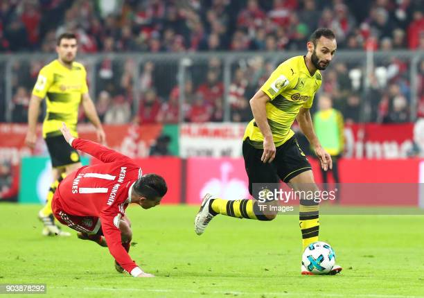 James Rodriguez of Muenchen and Oemer Toprak of Dortmund battle for the ball during the DFB Cup match between Bayern Muenchen and Borussia Dortmund...