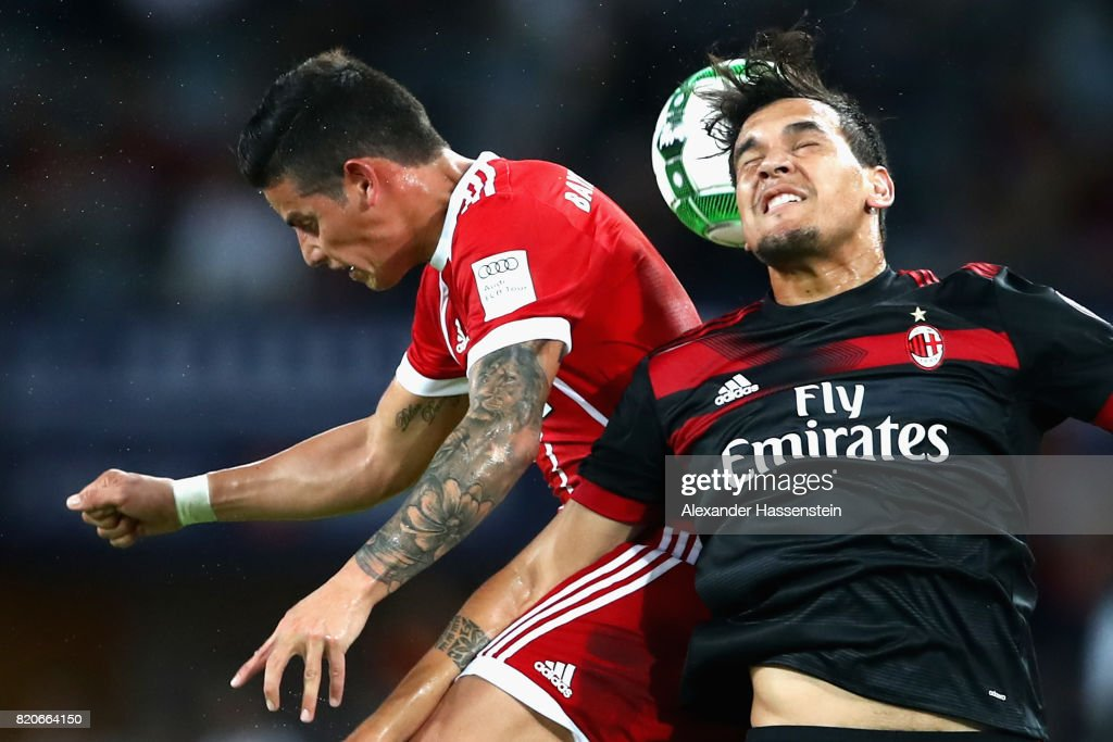 James Rodriguez of Muenchen battles for the ball with Gustavo Gomez (R) of Milan during the International Champions Cup Shenzen 2017 match between Bayern Muenchen and AC Milan at on July 22, 2017 in Shenzhen, China.