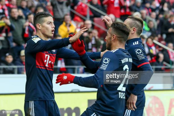 James Rodriguez of Muenchen celebrates after scoring his team`s second goal with team mates during the Bundesliga match between 1 FSV Mainz 05 and FC...