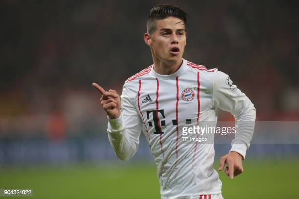 James Rodriguez of Muenchen celebrates after scoring his team`s third goal during the Bundesliga match between Bayer 04 Leverkusen and FC Bayern...