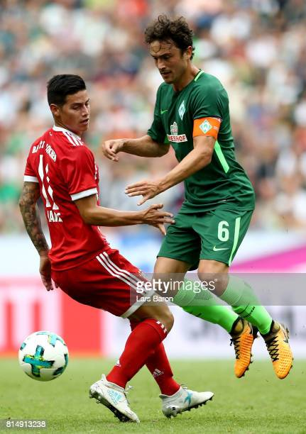 James Rodriguez of Muenchen challenges Thomas Delaney of Bremen during the Telekom Cup 2017 Final between SV Werder Bremen and FC Bayern Muenchen at...