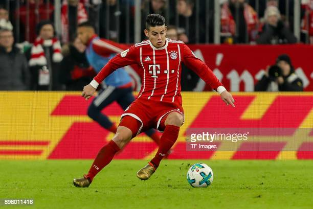 James Rodriguez of Muenchen controls the ball during the DFB Cup match between Bayern Muenchen and Borussia Dortmund at Allianz Arena on December 20...