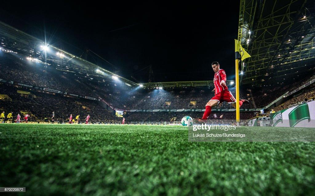 James Rodriguez of Munich kicks a corner during the Bundesliga match between Borussia Dortmund and FC Bayern Muenchen at Signal Iduna Park on November 4, 2017 in Dortmund, Germany.
