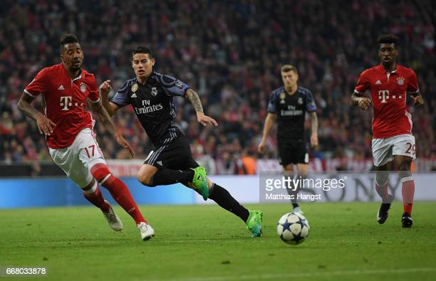 James Rodriguez of Real Madrid and Jerome Boateng of FC Bayern Muenchen compete for the ball during the UEFA Champions League Quarter Final first leg...