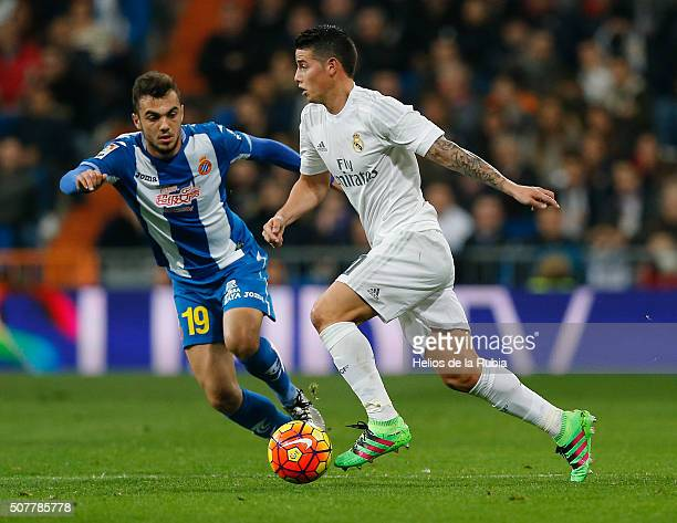 James Rodriguez of Real Madrid and Joan Jordan of Espanyol compete for the ball during the La Liga match between Real Madrid CF and Real CD Espanyol...
