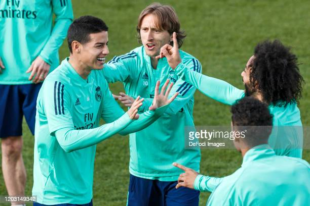 James Rodriguez of Real Madrid and Marcelo Vieira of Real Madrid gestures ahead of their UEFA Champions League round of 16 first leg match against...