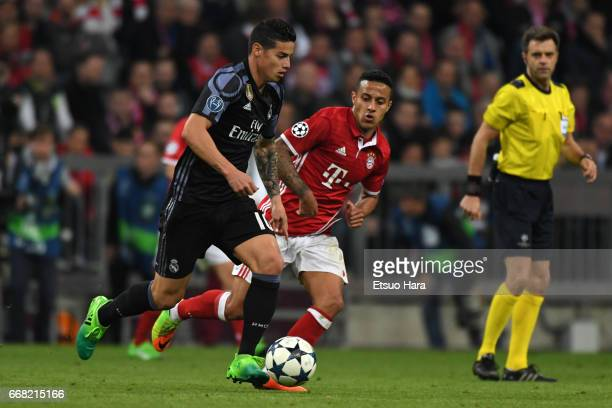 James Rodriguez of Real Madrid and Thiago Alcantara of Bayern Muenchen compete for the ball during the UEFA Champions League Quarter Final first leg...