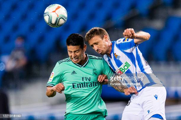 James Rodriguez of Real Madrid battles for the ball with Nacho Monreal of Real Sociedad during the Liga match between Real Sociedad and Real Madrid...
