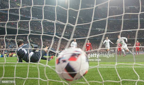 James Rodriguez of Real Madrid beats Sergio Rico of Sevilla FC to score Real's 3rd goal from the penalty spot during the Copa del Rey Round of 16...