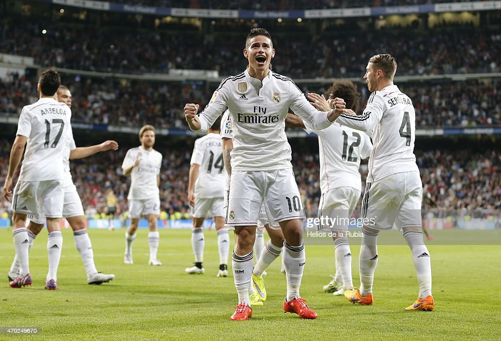 James Rodriguez (C) of Real Madrid celebrates after scoring during the La Liga match between Real Madrid CF and Malaga at Estadio Santiago Bernabeu on April 18, 2015 in Madrid, Spain.