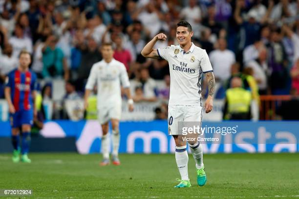 James Rodriguez of Real Madrid celebrates after scoring his team's second goal during the La Liga match between Real Madrid and FC Barcelona at...