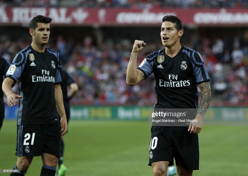 James Rodriguez (L) of Real Madrid celebrates after scoring his team's second goal during the La Liga match between Granada CF and Real Madrid CF at Estadio Nuevo Los Carmenes on May 6, 2017 in Granada, Spain.
