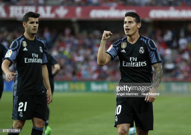 James Rodriguez of Real Madrid celebrates after scoring his team's second goal during the La Liga match between Granada CF and Real Madrid CF at...