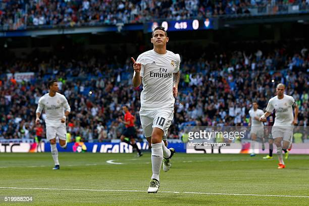 James Rodriguez of Real Madrid celebrates after scoring the opening goal during the La Liga match between Real Madrid CF and SD Eibar at Estadio...