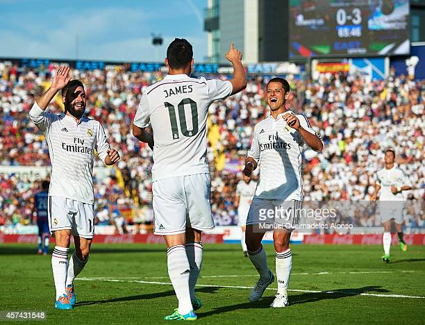 James Rodriguez of Real Madrid celebrates after scoring with his teammates Daniel Carvajal and Javier 'Chicharito' Hernandez during the La Liga match...